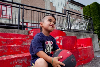 "Cambridge resident Charles Joseph ""CJ"" DuPont, 11, was born with a disability called achondroplasia, or dwarfism, and on Saturday, Aug. 3, his mom is organizing a fundraiser at Donnelly Field in East Cambridge to raise money for a lifetime membership to the Little People of America - a national organization that supports little people. Cambridge Chronicle staff photo by Erin Baldassari."