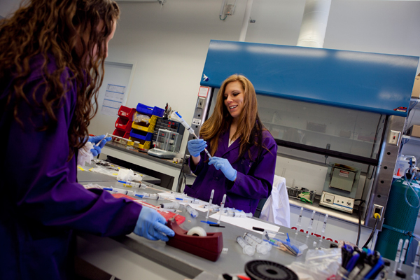 Chemists Nokole Seil, right, and Samantha Beanvegard work on polymer composists for start up company, 206 Ortho, which rents space at the Lowell medical device incubator, M2D2. Photo by Erin Baldassari/Banker & Tradesman.