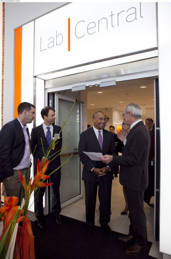 Lab Central co-founders Tim Rowe, Johannes Fruehauf, Gov. Deval Patrick, and MIT President Rafael Reif (l-r) make small talk before the opening of the new shared lab space in Kendall Square, Wed. Aug. 2. Photo by Erin Baldassari/Banker & Tradesman.