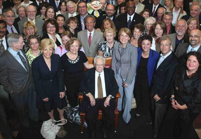 Carl Barron surrounded by family, colleagues and several notable public officials, including Mass. Attorney General Martha Coakley (right of Barron) and then-Deputy City Manager Richard Rossi (behind Barron), among many others. Courtesy photo.