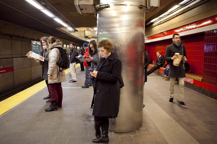 "Somerville resident Andrea Deeker passes through Cambridge every day on the Red Line on her way to work. She said she has a car, but prefers to take the subway as a ""lifestyle choice."" Photo by Erin Baldassari/Wicked Local Cambridge."