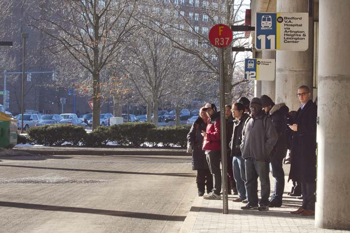 Passengers wait for a bus at Alewife Station for their Monday morning commute. Cambridge's transportation staff has recommended the city invest in the underfunded MBTA system, especially for buses. Photo by Erin Baldassari/Wicked Local Cambridge.