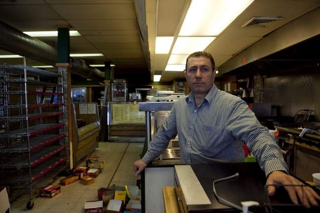 Gourmet Express co-owner, Moujib Hamza, said the store may not come back after being a Porter Square staple for more than 20 years. The convenience store and late-night food spot closed to make way for a 27-unit building. Wicked Local photo/Erin Baldassari