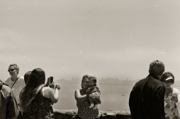 Tourists take pictures of themselves in from of San Francisco.