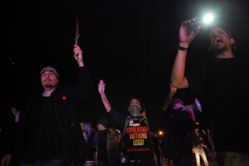 Demonstrators in Oakland made it onto the on-ramp of Interstate Highway 580 near 35th street during the second day of protesting a grand jury's failure to indict Ferguson, Missouri, Officer Darren Wilson in the death of Michael Brown, Tuesday, Nov. 25, 2014. Photo by Erin Baldassari/Bay City News Service.