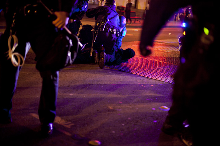 Police tackled a protester to the ground and arrested him during the third night of protests in Oakland against a grand jury's decision not to indict Ferguson, Mo., Officer Darren Wilson in the Aug. 9 shooting death of Michael Brown, Wednesday, Nov. 26, 2014. Photo by Erin Baldassari/Bay City News Service.
