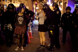 Police arrested two demonstrators during the third night of protests in Oakland against a grand jury's decision not to indict Ferguson, Mo., Officer Darren Wilson in the Aug. 9 shooting death of Michael Brown, Wednesday, Nov. 26, 2014. Photo by Erin Baldassari/Bay City News Service.
