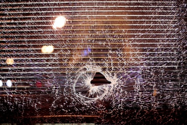 Vandalism was a frequent occurence during the third night of protests in Oakland against a grand jury's decision not to indict Ferguson, Mo., Officer Darren Wilson in the Aug. 9 shooting death of Michael Brown, Wednesday, Nov. 26, 2014. Photo by Erin Baldassari/Bay City News Service.