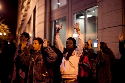 Police tried to wear protesters out by making them move quickly and separating large groups during the third night of protests in Oakland against a grand jury's decision not to indict Ferguson, Mo., Officer Darren Wilson in the Aug. 9 shooting death of Michael Brown, Wednesday, Nov. 26, 2014. Photo by Erin Baldassari/Bay City News Service.