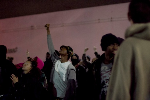 Demonstrators stopped in front of the Glenn Dyer Detention Facility, a jail, in Oakland during the third night of protests against a New York grand jury's decision not to indict a white police officer in the chokehold death of Eric Garner, Friday, Dec. 5, 2014.