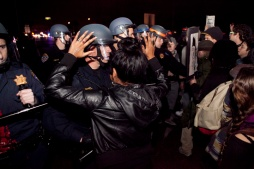 Demonstrators resisted leaving Interstate Highway 880 after police arrived to force them off the freeway during the third night of protests in Oakland against a New York grand jury's decision not to indict a white police officer in the chokehold death of Eric Garner, Friday, Dec. 5, 2014.