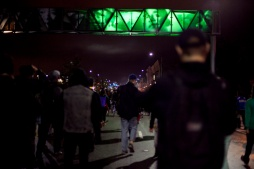 Demonstrators marched down 7th Street towards the West Oakland BART station during the third night of protests in Oakland against a New York grand jury's decision not to indict a white police officer in the chokehold death of Eric Garner, Friday, Dec. 5, 2014.