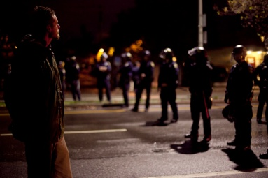 Police cordoned off 27th Street at Telegraph Avenue during the third night of protests in Oakland against a New York grand jury's decision not to indict a white police officer in the chokehold death of Eric Garner, Friday, Dec. 5, 2014.