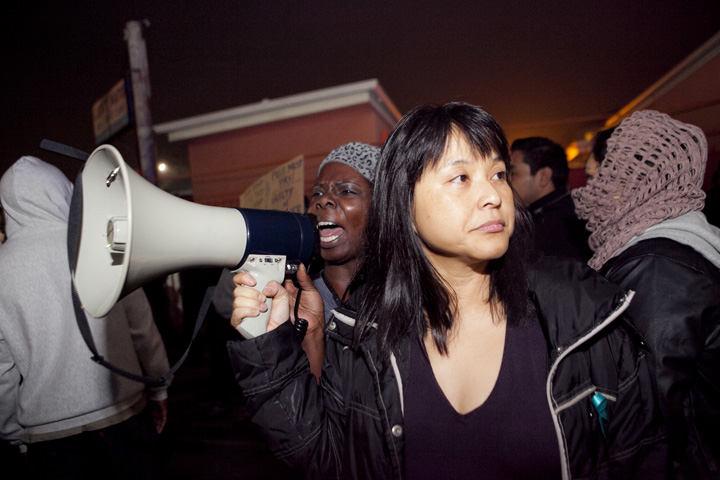 Oakland resident Sophia Smith calls out for justice as By Any Means Necessary organizer Yvette Felarca holds a megaphone. It was the second day of demonstrations in Oakland against a grand jury's decision not to indict a New York police officer in the choke-hold death of Eric Garner, Thursday, Dec. 4, 2014. Photo by Erin Baldassari/Bay City News Service.