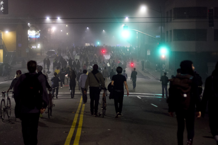 Demonstrators marched down International Avenue in East Oakland during the second day of protests against a grand jury's decision not to indict a New York police officer in the choke-hold death of Eric Garner, Thursday, Dec. 4, 2014. Photo by Erin Baldassari/Bay City News Service.