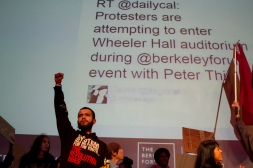 Demonstrators took over a talk at Wheeler Hall in UC Berkeley with PayPal cofounder Peter Thiel during the sixth night in as many days to protest two grand jury decisions not to indict white police officers in the deaths of unarmed black men, Wednesday, Dec. 10, 2014. Photo by Erin Baldassari/Bay City News Service.