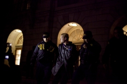 A man was arrested outside Wheeler Hall at UC Berkeley after demonstrators took over a talk with PayPal cofounder Peter Thiel during the sixth night of protests against two grand jury decisions not to indict white police officers in the deaths of unarmed black men, Wednesday, Dec. 10, 2014. Photo by Erin Baldassari/Bay City News Service.