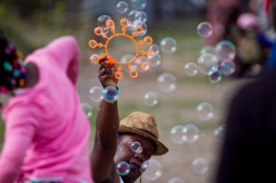 Bushmama Africa creates bubbles during the Bay Area Vibez Festival at the Middle Harbor Shoreline Park, Sunday, Sept. 28, 2015. Photo by Erin Baldassari/East Bay Express.