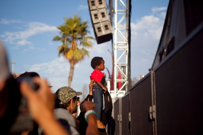 A child is passed to the stage during a freestyle performance by Supernatural at the Bay Area Vibez Festival at the Middle Harbor Shoreline Park, Sunday, Sept. 28, 2015. Photo by Erin Baldassari/East Bay Express.
