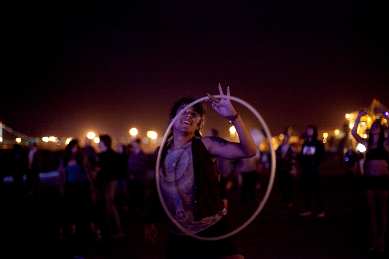 Xenia Gonzalez of Oakland dances with a hula hoop at the Bay Area Vibez Festival at the Middle Harbor Shoreline Park, Sunday, Sept. 28, 2015. Photo by Erin Baldassari/East Bay Express.